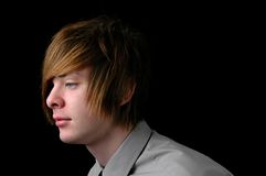 Profile of Teen. Teenager with shirt and tie over a black background (Profile view Royalty Free Stock Photography