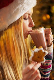 Profile teenager girl drinking hot chocolate Stock Photography