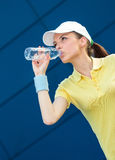 Profile of tennis player drinking water Stock Photography