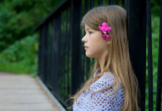 Profile of thoughtful young girl Stock Images