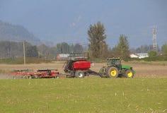 Profile of Tilling Farm Equipment Stock Image