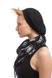 Profile of trendy young woman. In sleeveless top, scarf and cap Royalty Free Stock Image