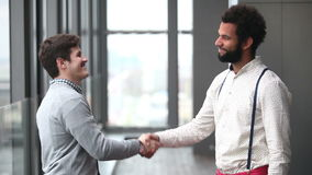 Profile of two advertising executives shaking hands. Profile of two handsome advertising executives shaking hands stock footage