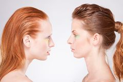Profile of two red-haired woman Stock Photo