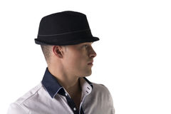 Profile view of attractive young man with fedora and white shirt Royalty Free Stock Images