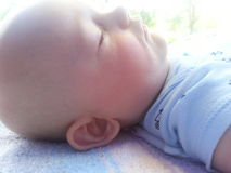 Profile View of Baby Boy Asleep royalty free stock images
