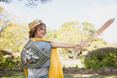 Profile view of boy dressing up in knight Stock Images