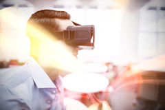 Profile view of businessman holding virtual glasses. In a office Royalty Free Stock Photo