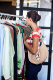 Profile view of businesswoman searching clothes Stock Photos