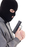 Profile view of criminal man in mask holding gun isolated on whi Stock Photography