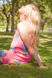 Profile view of cute young woman enjoying the sun Royalty Free Stock Photography