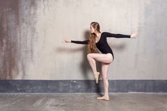 Profile view. Experienced confident dancer having a rehearsal. Indoor shot stock images