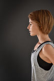 Profile view of fitness woman. Cheerful fitness girl on grey background, isolated Stock Photo