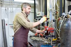 Using Bottle Capper at Brewery stock image