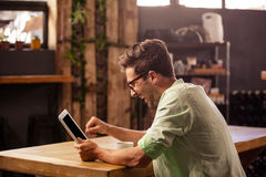 Profile view of hipster man using tablet Royalty Free Stock Photography