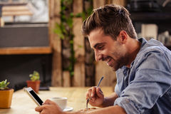 Profile view of hipster man using tablet at cafe Royalty Free Stock Image