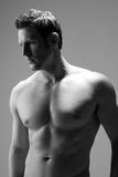 Profile view of a hunky caucasian man. Masculine caucasian man in monochrome photograph royalty free stock photography