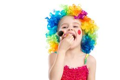 Profile view of little girl in clown wig Stock Photography