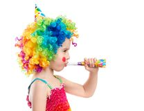 Profile view of little girl in clown wig Stock Photos