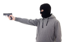 Profile view of man in mask aiming with gun isolated on white Stock Images