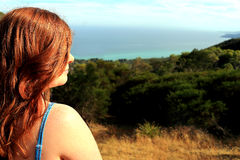 Profile view of a red-haired woman. Royalty Free Stock Photos