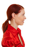 Profile view of a redhaired woman Royalty Free Stock Photos