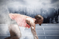 Composite image of profile view of runner preparing for the start Royalty Free Stock Photo