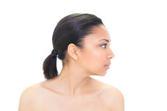 Profile view of a serious dark haired model posing Stock Photography