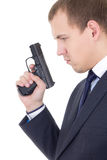 Profile view of serious man in business suit with gun isolated o Stock Image