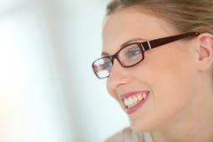 Profile view of smiling woman wearing eyeglasses Stock Image