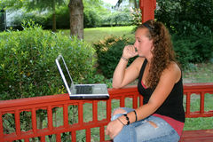 Teen Girl Studying Laptop Outdoors Royalty Free Stock Images