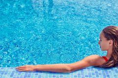 Profile view of teenage girl in the swimming pool royalty free stock images