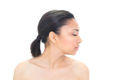 Profile view of a thoughtful dark haired model closing her eyes Stock Photo