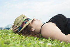 Profile view of woman relaxing on grass Stock Image