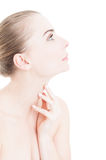 Profile view of woman touching her neck skin Royalty Free Stock Photo