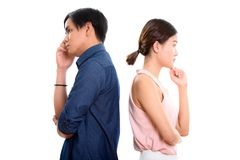 Profile view of young Asian couple thinking together with backs. Against each other stock images