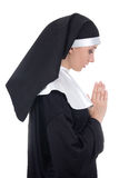 Profile view of young beautiful woman nun praying isolated on wh Royalty Free Stock Photography