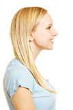 Profile view of young blonde woman Royalty Free Stock Photos