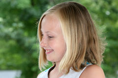 Profile view of a young girl smiling Stock Photos