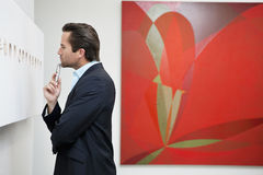 Profile view of a young man in a art art gallery Stock Image