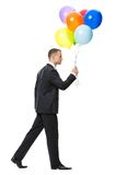 Profile of walking with balloons businessman Royalty Free Stock Image
