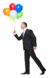 Profile of walking with balloons manager. Profile of walking with colorful balloons business man, isolated on white. Concept of leadership and success Stock Images