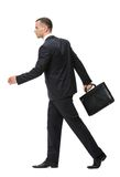 Profile of walking with black case businessman Stock Images