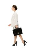 Profile of walking business woman with black case Royalty Free Stock Photography