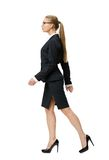 Profile of walking businesswoman Stock Photos