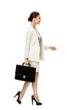Profile of walking businesswoman with suitcase Royalty Free Stock Photography