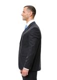Profile of white collar. Profile of business man wearing black suit and blue tie, isolated on white Royalty Free Stock Images