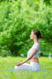 Profile of woman in asana position zen gesturing Stock Image