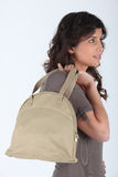 Profile of woman with bag Royalty Free Stock Photography