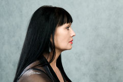 Profile of the woman in a black dress stock images